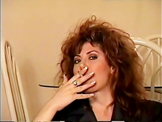classic 80s smoking, huge hair and all