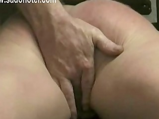 masked slave is hand fucked by her master and