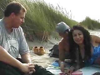 lady gets two on the sea coast