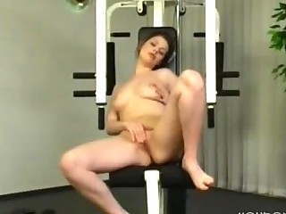 fisting herself on the fitness mechanism