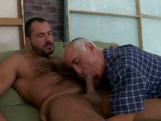 an granny male is licking his fellows penis