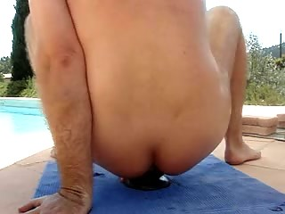 fingering bottom near the swimingpool