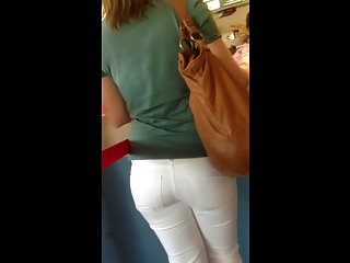 butt - pretty lady into colorless taut pants