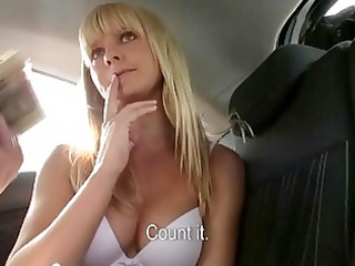 blonde loveliness rides a huge penis inside a car
