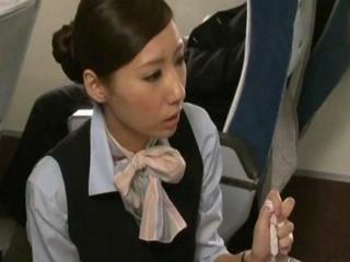 japanese stewardess giving a handjob