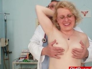blonde lady wears glasses and obtain milky enema